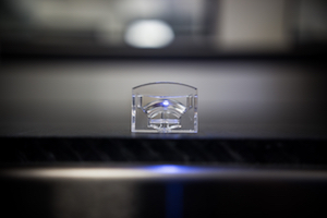 Zeiger showcases the molding of an automotive LED headlamp optic at NPE